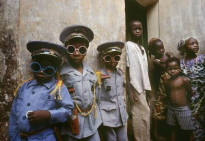 Three children in Kano dressed in uniforms bought by their father during his last pilgrimage to Mecca. Kano. 1982
