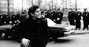 Phil Ochs with His Guitar Standing in Front of a Line of Police Officers --- Image by © Michael Ochs Archives/Corbis